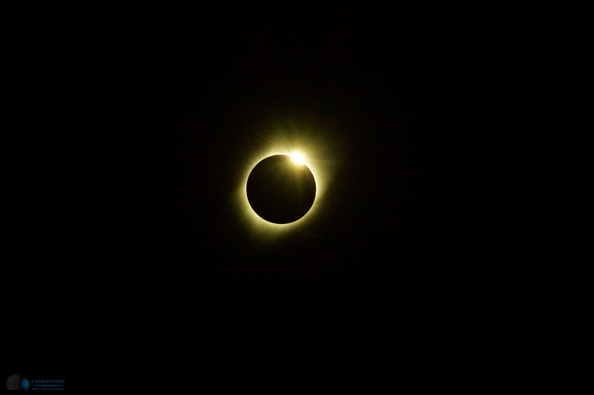 First Diamond - First glimpse of the diamond ring as the totality ends. by 4 Hemispheres Photography