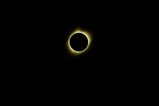 The corona and its flares remain visible throughout totality.