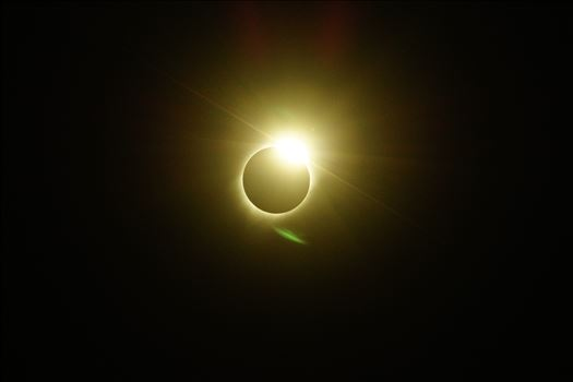 Flaring rays form as if from diamond ring facets as the sun's body begins to emerge from the lunar totality.
